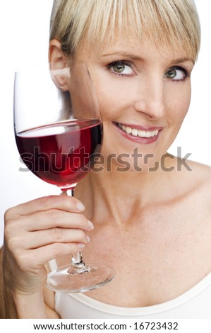 young blond woman holding glass of red wine