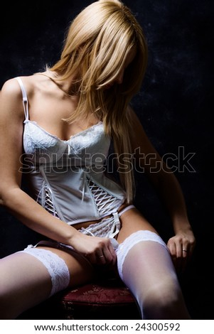 young blond woman in lingerie - stock photo