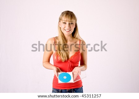 young blond woman in red blouse offers an advertising media and smiles - stock photo