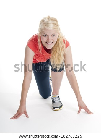 young blond woman in start position - stock photo