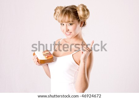 young blond woman in white shirt with a fastfood box - stock photo