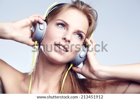 young blond woman listening to music