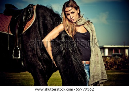 young blond woman outdoor portrait with horse, autumn day