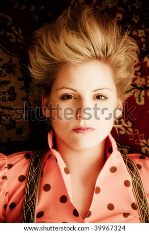Young blond woman portrait staring at camera. - stock photo
