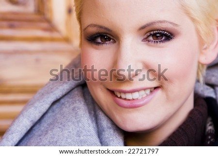Young blond woman smiling at camera - stock photo