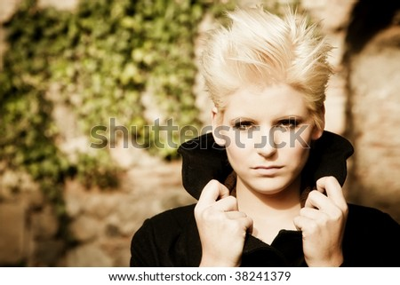 Young blond woman wearing winter coat. - stock photo