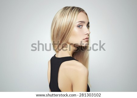 Young blond woman with blue eyes.Beautiful blonde Girl - stock photo