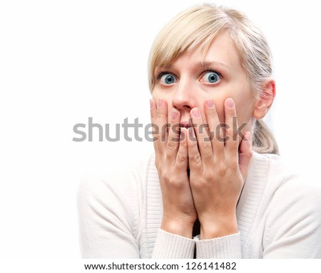 young blond woman with  expression of surprise on his face - stock photo