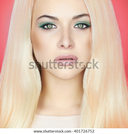 Young blond woman with green eyes.Beautiful Girl with make-up.close-up fashion portrait on pink background - stock photo