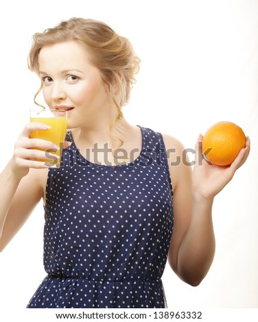 Young blond  woman with oranges in her hands