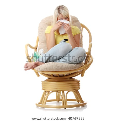Young blond woman with remote control watching tv and crying - stock photo