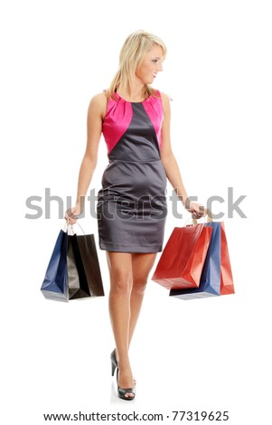 Young blond woman with shopping bags, isolated on white