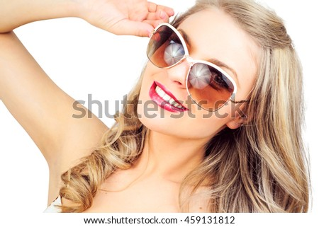 Young blond woman with sunglases, studio white. Summer concept