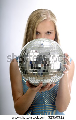 Young blond women with disco ball isolated on white - stock photo