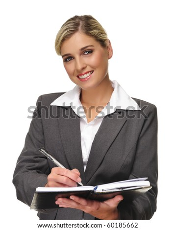 Young blonde business woman writes in her personal planner