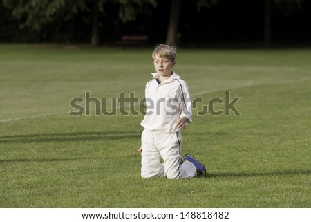 young blonde cricketer fielding