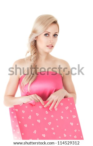 Young blonde fashion woman with shopping bag isolated on white background