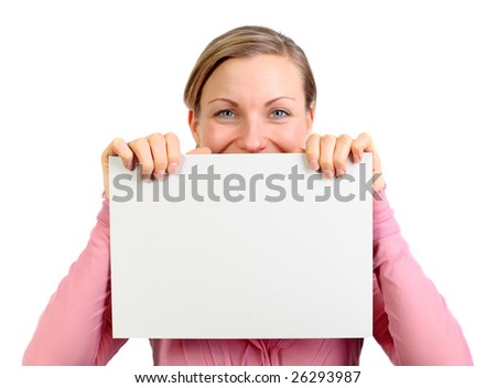 young blonde female holding a white card with both hands above her mouth (isolated on white)