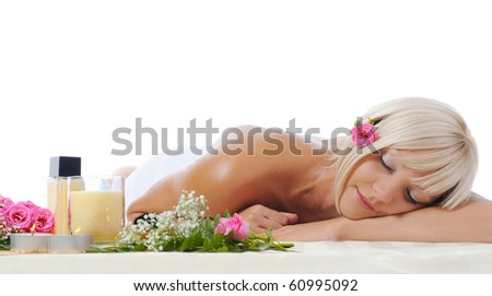 Young blonde girl at spa procedure Isolated on white background - stock photo