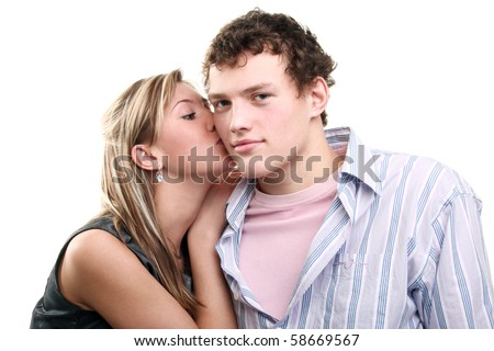young blonde girl kissing her boyfriend - stock photo