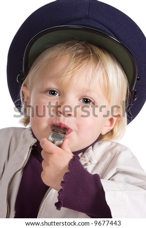 Young blonde girl paying with a police whistle