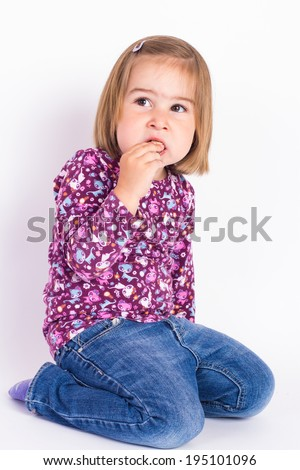 Young blonde haired girl holds a chocolate wafer cookie