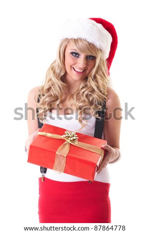 Young blonde happy girl in santa hat hold red gift, isolated on white