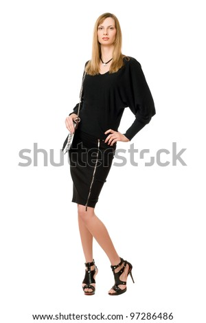Young blonde in black  in full length - stock photo
