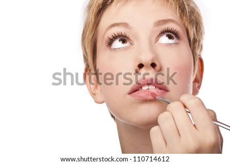 Young blonde lipstick. Studio, white background - stock photo