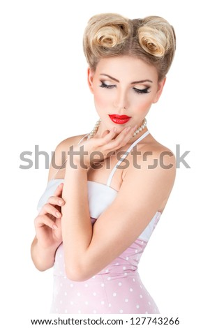 Young blonde pin-up woman with retro style makeup and hairdo isolated on white background