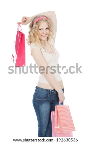 Young blonde teenage girl with pink shopping bags over white background