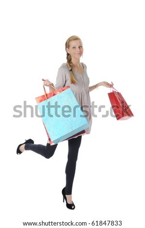 young blonde with shopping bags. Isolated on white background