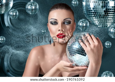 Young blonde woman at night disco club - stock photo