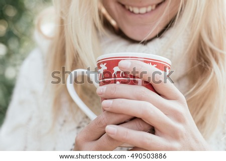 Young blonde woman drinking outdoor