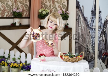 young blonde woman drinking tea