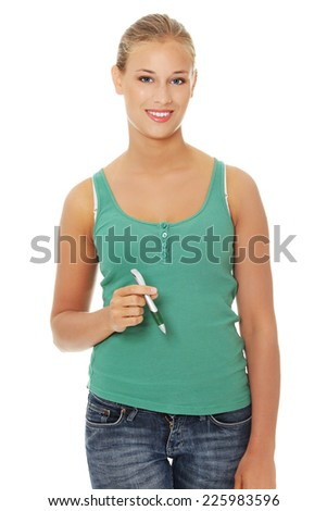 Young blonde woman holding a pen - stock photo