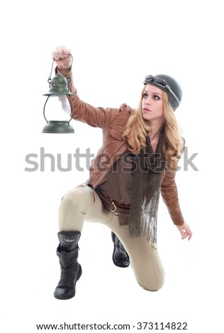 young blonde woman in a steampunk outfit, holding a gun, action hero pose. isolated on white background. - stock photo