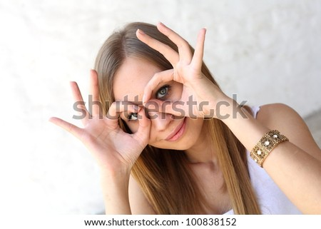 Young blonde woman making funny faces closeup - stock photo