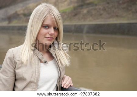 young blonde woman near the river