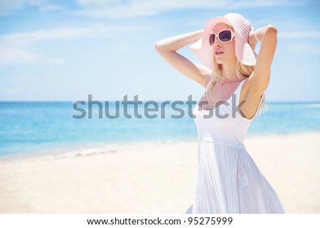 Young blonde woman on the beach, bali - stock photo