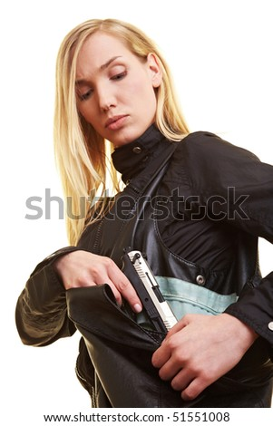 Young blonde woman pulling a pistol out of her handbag