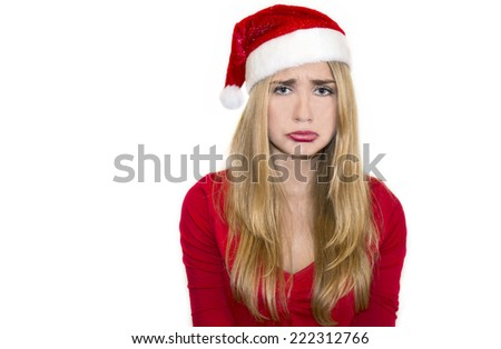 Young blonde woman sad in christmas day - stock photo