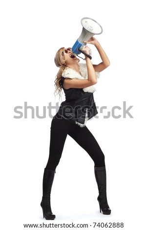 Young blonde woman  shouting through  megaphone - stock photo