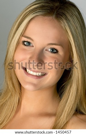 Young Blonde Woman Smiling Headshot - stock photo