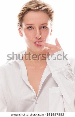 young blonde woman sucking her finger on white background - stock photo