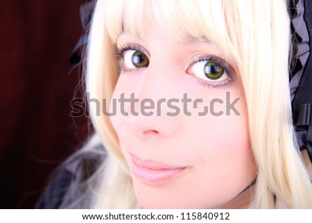 young blonde woman wearing color contact lenses - stock photo