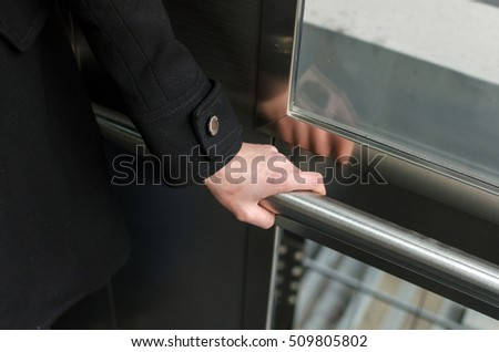 Young blonde woman with a short hair uses elevator