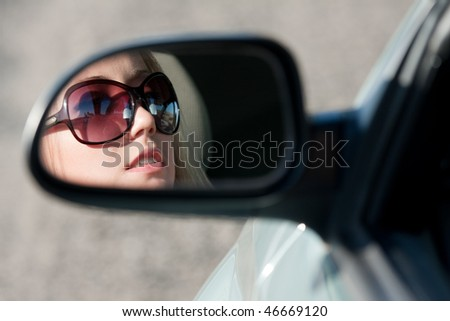 young blonde women driver - stock photo