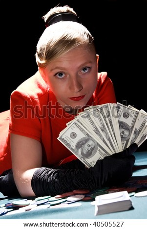 Young blondy woman holding large sum of dollar cash - stock photo