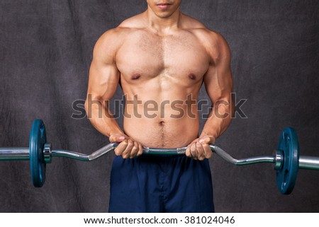 Young body builder lifting weights - stock photo